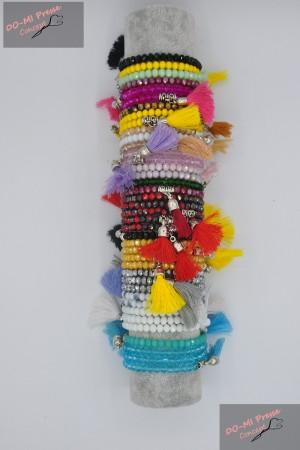 Bracelets perles et pompons